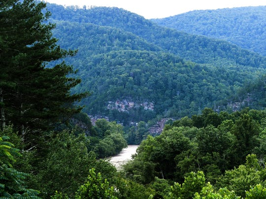 A view of the French Broad River and the surrounding mountains from Paint Rock Farm in Hot Springs on Saturday, July 7, 2018.