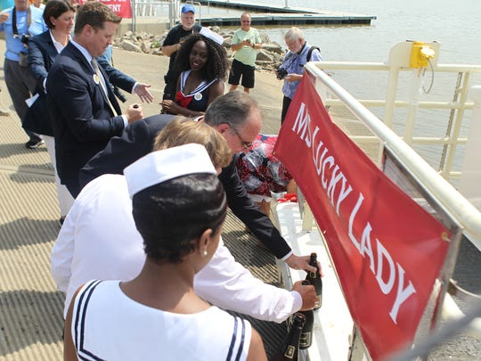 Local politicians and Dan Lee christen the ferry between
