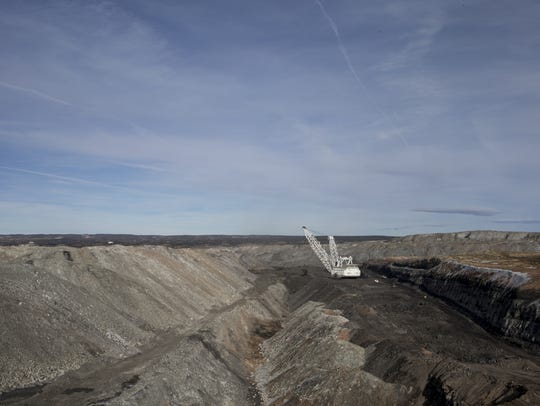 A dragline removes overburden in pit J19, February