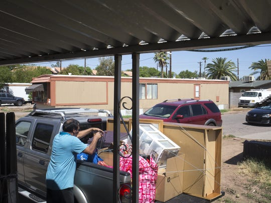 Jorge Flores packs his vehicle, July 19, 2018, at the Tempe Mobile Home Park, 2015 E. University Drive, Tempe. Jorge and his family have lived in the park for 18 years, but all residents must be out by Friday, July 27.