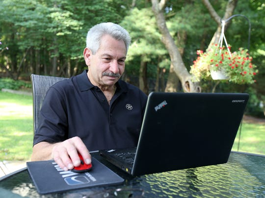 Sandy Vosk, owner of Advantage Technology Solutions Inc., works from his home in Marlboro, NJ Monday August 6, 2018.