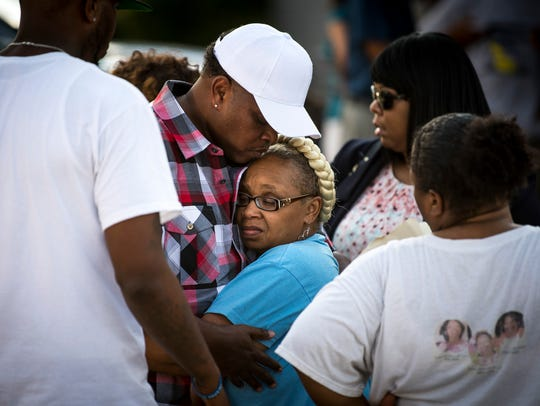 Vickie Hambrick, mother of Daniel Hambrick, is comforted