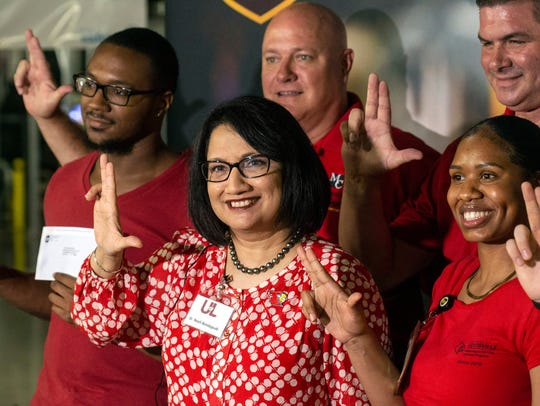 UofL president Dr. Neeli Bendapudi poses with some