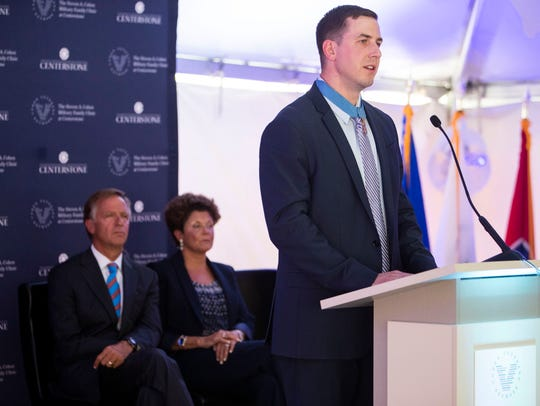 Staff Sgt. Ryan M. Pitts speaks during the grand opening