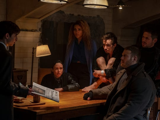 "Aidan Gallagher, Ellen Page, Emmy Raver-Lampman, Robert Sheehan, Tom Hopper and David Castaneda in ""The Umbrella Academy."""