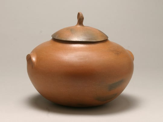 A traditional bean pot by Pam Lujan-Hauer made from micaceous clay that is used for the Taos Pueblo religion.