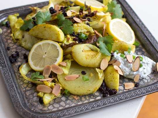 This Dec. 8, 2014 photo shows curried roasted cabbage
