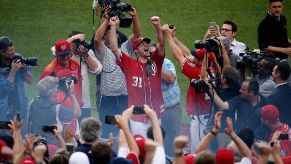 Starting pitcher Max Scherzer  of the Washington Nationals celebrates after throwing a no hitter during the Nationals 6-0 win over Pittsburgh Pirates at Nationals Park on June 20, 2015 in Washington, DC.
