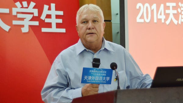 Tallahassee Realtor Bob Teel speaks at a business conference this summer in Tianjin, China. He was recently honored with a full professorship at Tianjin Foreign Studies University's School of Business, where he teaches for both TCC and FSU international studies programs.