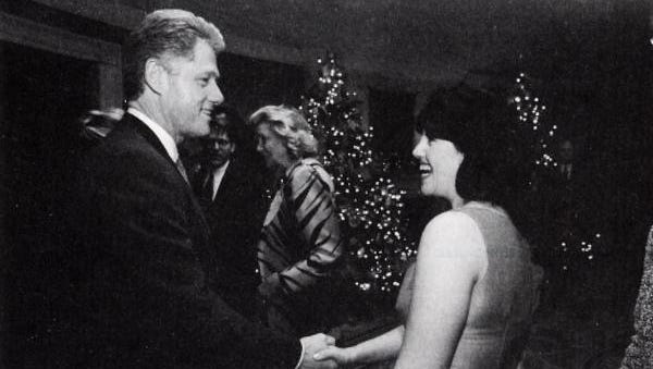 President Bill Clinton and Monica Lewinsky shake hands at a Christmas party in 1996.