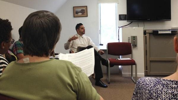 Juan Pablo Ramirez, co-chairman of the Rockland Immigration Coalition, leads a meeting July, 11, 2014 in Spring Valley.