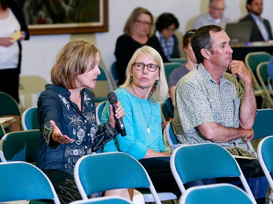 Susan Palko-Schraa, left, a member of the San Juan County Gold King Mine Citizens Advisory Committee, speaks during a public meeting Thursday at the Henderson Fine Arts Center at San Juan College. At right are Diane and Michael Schwebach of Cedar Hill.