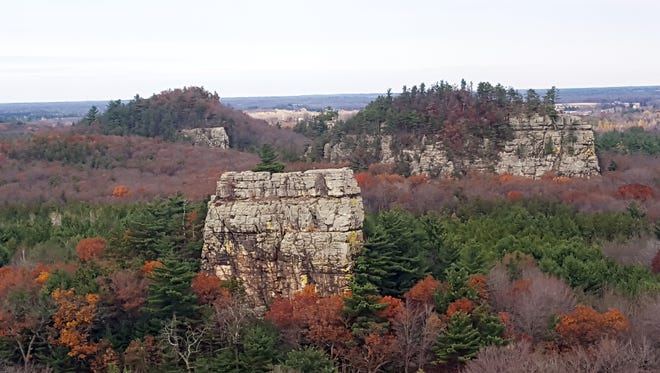 Bee Bluff (the square bluff in the foreground) is among the prominent rock formations visible at Mill Bluff State Park near Camp Douglas.