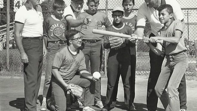"""In this circa 1950s photo, Don Murray,  at right, coaches KPAA softball players.  Harold """"Shifty"""" Gears is seen at center, pointing."""