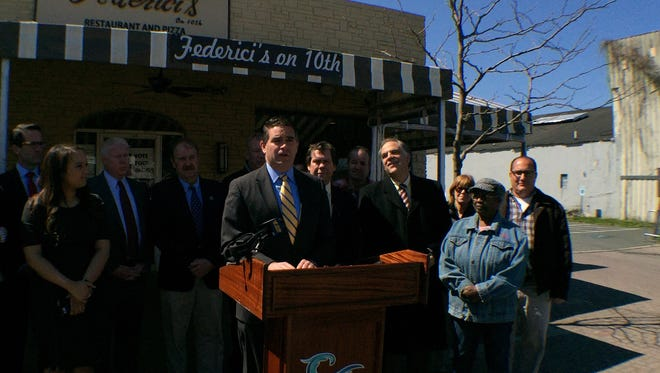 Belmar Mayor Matt Doherty, surrounded by other Jersey Shore mayors and advocates, speaks out against a proposed New Jersey Natural Gas rate hike at a news conference in Belmar on Wednesday, April 13.