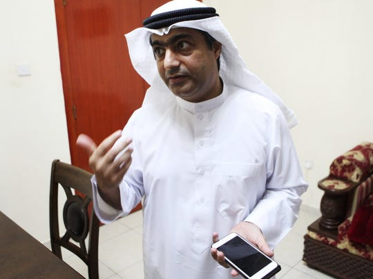 Human rights activist Ahmed Mansoor shows Associated