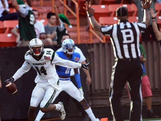 USP NCAA FOOTBALL: HAWAII BOWL-HAWAII AT MIDDLE TE S FBC USA HI