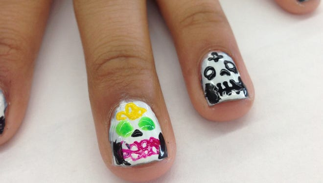Sugar Skull Nails. Get in the season for Dia de los Muertos by painting your nails for the occasion.