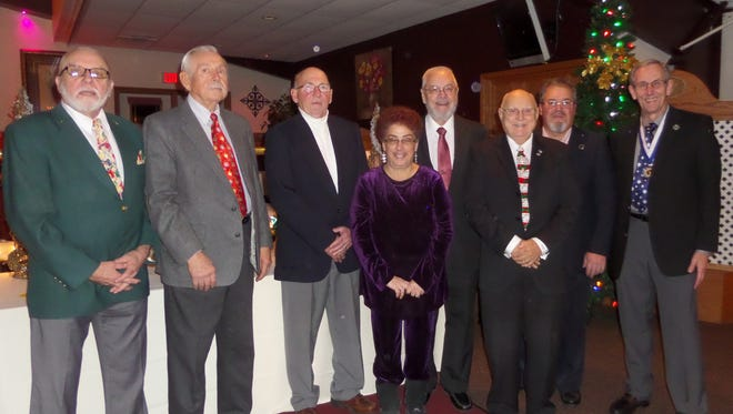 The Golden K celebrated the holiday season with a Christmas dinner at Knox's Silver Valley Banquet Hall where it installed its first female president - Diana Reynolds - in front of 50 members and guests. From left are past president Gary Prigge, board members Myron Halla and Ron Strzyzewski, Reynolds, board member Jim Van Sleet, president elect Al Nelson, board member Don Mueller and treasurer Ron VonDrachek.