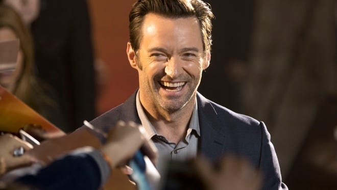 """Actor Hugh Jackman signs autographs after a press conference for the movie """"Logan"""" in Beijing, China, Wednesday, March 1, 2017, just days after sending his best to the cast of North Rockland High School's """"Les Miserables."""""""