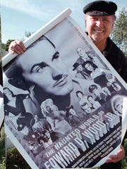 Conrad Brooks holds a poster from an Ed Wood documentary. Starring in Wood's terrible films made Brooks a cult star.