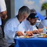 Gus Silivos, of Skopelos, samples a dish from the team challenge cook-off Saturday during Taste of the Beach at Pensacola Beach.The teams had 30 minutes to cook a dish with lionfish and a mystery ingredient, then it was judged by five Pensacola Celebrity Chefs, Gus Silivos, Dan Dunn, Irv Miller, Jim Shirley and Frank Taylor.