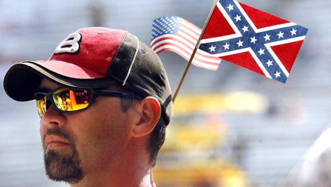 James Armstrong from Des Moines, Iowa, flew his colorful flags, including the controversial Confederate flag, at the Indianapolis Speedway before the Brickyard 400 race on July 29, 2007. Indianapolis Motor Speedway officials say they will comply with NASCAR's request to not display the flag for this year's race.