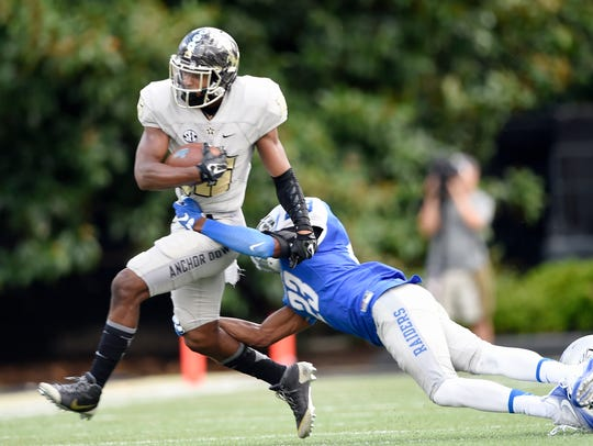 MTSU safety Chris Brown (23) tries to stop Vanderbilt
