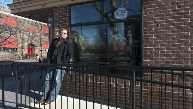 Joseph M. Paprzycki, founder of the South Camden Theatre Company, stands outside the Waterfront South theater in 2014.