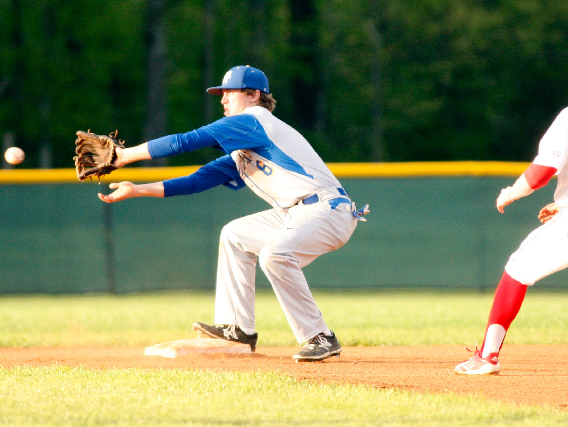 Mountain Home second baseman Zane Walker takes a throw as Cabot's Dylan Bowers slides into second base.