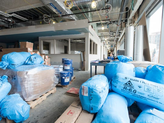 Construction equipment fills the waiting area of the