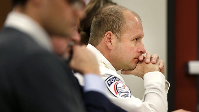 Police Chief Michael Sullivan listens to testimony during the first day of hearings in the misconduct case against Sullivan on Dec. 21, 2016, in Hortonville.