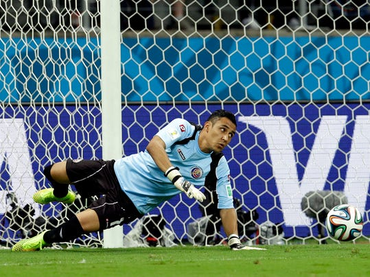 Costa Rica's goalkeeper Keylor Navas goes for the ball during the World Cup quarterfinal soccer match between the Netherlands and Costa Rica at the Arena Fonte Nova in Salvador, Brazil, Saturday, July 5, 2014. (AP Photo/Hassan Ammar)