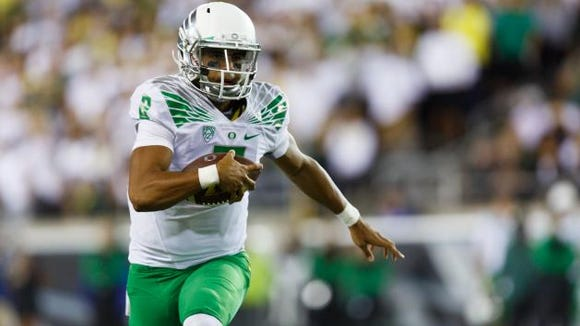 Leading Heisman Trophy candidate Marcus Mariota has No. 5 Oregon in a prime spot to earn a playoff spot.