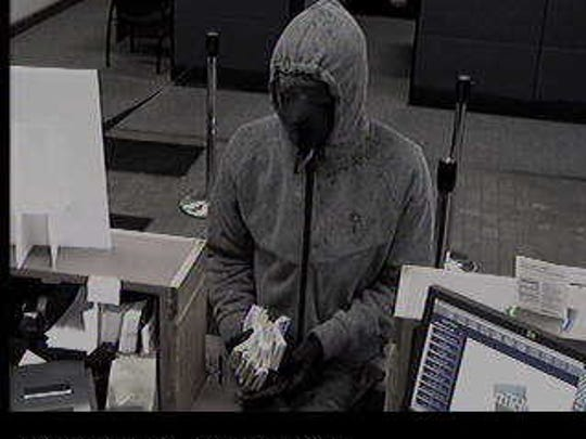 Surveillance footage of the person suspect of robbing the M&T Bank branch in Spencerport on Tuesday.