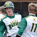 St Xavier pinch runner Stephen Mitchell celebrates with his team mates after scoring a run during the game against  Central Hardin.
