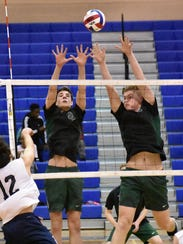 A pair of Carlisle defenders jump to block a kill by