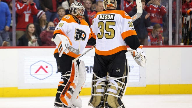 Michal Neuvirth, left, got the first start for the Flyers out of the bye week.