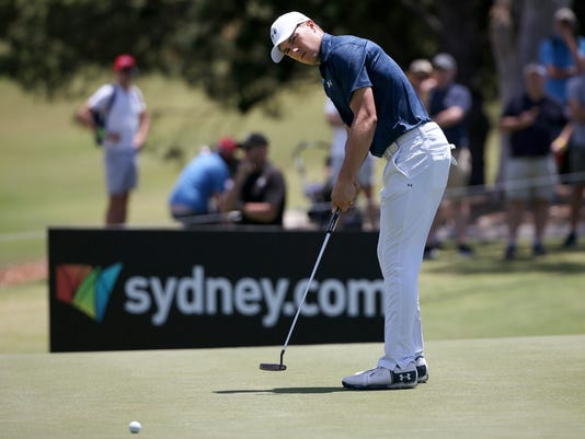 Jordan Spieth of the U.S. putts on the 10th green during the fourth round of the Australian Open Golf tournament in Sydney, Sunday, Nov. 26, 2017. (AP Photo/Rick Rycroft)
