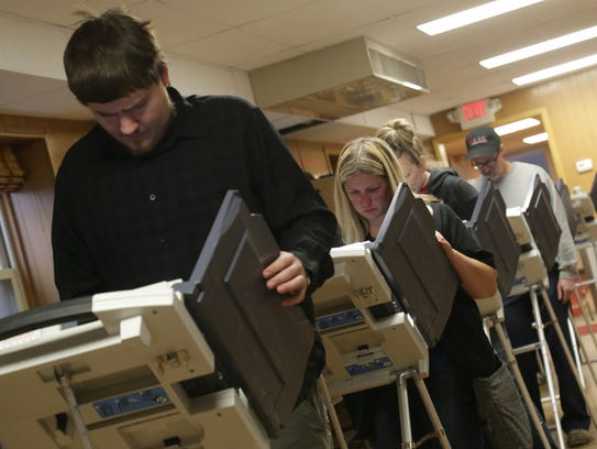 Voters line up to cast their ballots at Grace Episcopal