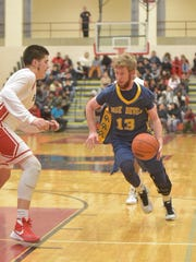 Greencastle's Sam Sprague, right, looks for a lane against Oenis Medina, of Reading, on Wednesday night during the District 3 Class AAAA playoffs. Reading won, 73-55.