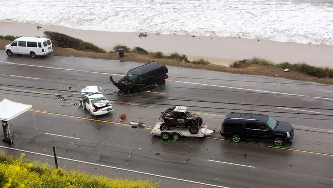 Bruce Jenner's SUV (right) with a trailer is seen at the scene of a car crash where one person was killed Saturday, Feb. 7, 2015, on the Pacific Coast Highway in Malibu, Calif.