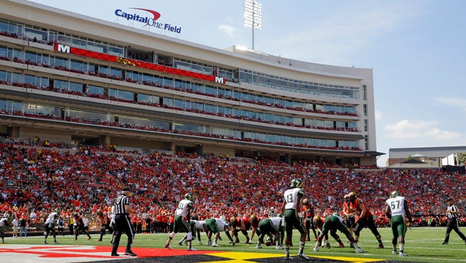 Maryland and South Florida players line up for a play during an NCAA college football game, Saturday, Sept. 19, 2015, in College Park, Md.
