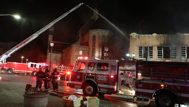 Yonkers firefighters battle a five alarm fire at a row of stores at 5 South Broadway in the city, Oct. 23, 2015.