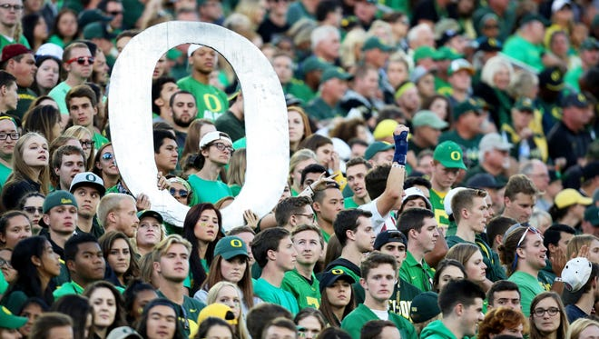 Oregon fans fill the stands during the first half of an NCAA college football game against Utah, Saturday, Sept. 26, 2015, in Eugene, Ore.