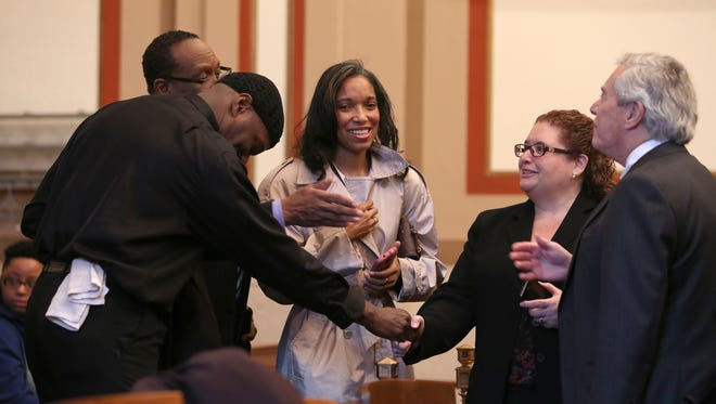 Tracie Hunter arrives in Judge Patrick J. Dinkelacker's courtroom at the Hamilton County Courthouse on Monday morning for a motion hearing asking the judge to dismiss the eight charges she faces.