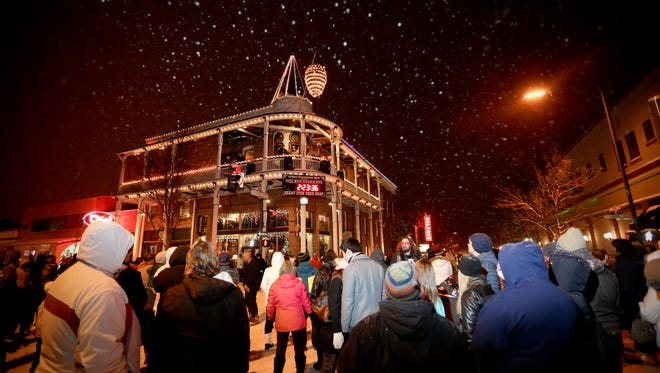New Year's Eve revelers can virtually watch the Weatherford Hotel's Great Pinecone Drop in Flagstaff, Ariz.