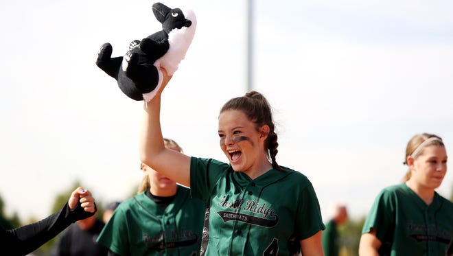 Fossil Ridge shortstop Haley Donaldson holds up a stuffed animal mascot after a win in the 2014 Class 5A state tournament. Donaldson was named the Colorado Gatorade Player of the Year in softball Thursday.