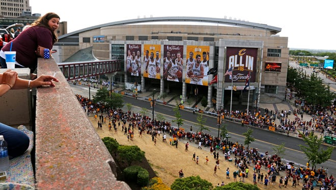 Cleveland Cavaliers fans gather at the Quicken Loans Arena early to watch a parade celebrating the team's NBA title.