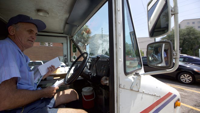Tim Kelly delivers the mail on the last week covering a postal route he has worked in Tallahassee since 1983. Kelly, an employee of the Post Office since 1978, is retiring this week and saying his goodbyes to customers he has delivered to for years.